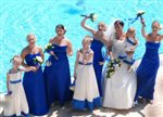 After the wedding ceremony everyone is relaxed at The Grecian Bay Hotel pool side in Cyprus
