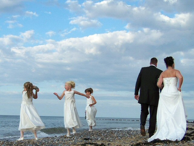 Reportage wedding photography Cromer beach.